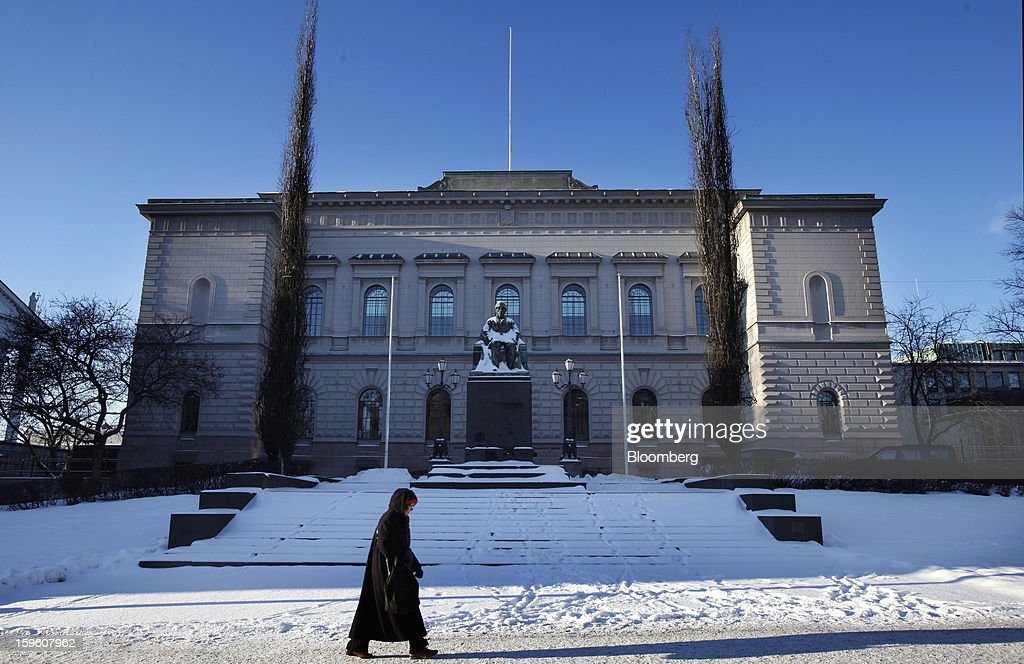 A pedestrian walks through snow past the Finnish central bank in Helsinki, Finland, on Thursday, Jan. 17, 2013. The pace of Finland's debt growth is alarming and the country must undertake economic reforms together with reining in spending, Finnish Prime Minister Jyrki Katainen said in an op-ed piece published in newspaper Savon Sanomat. Photographer: Ville Mannikko/Bloomberg via Getty Images