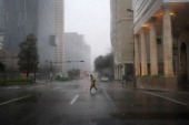 A pedestrian walks through the rain of Hurricane Isaac on August 29 2012 in New Orleans Louisiana The Category 1 hurricane is slowly moving across...