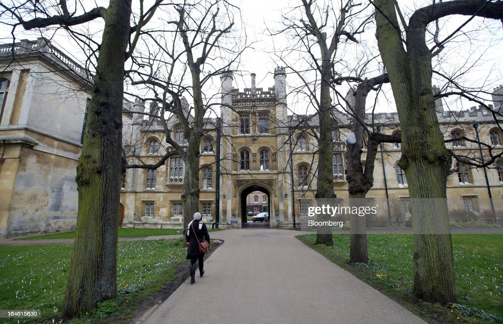 A pedestrian walks towards Trinity College, part of the University of Cambridge, in Cambridge, U.K., on Friday, March 22, 2013. In 2011, the U.K.'s government unveiled a plan to reduce state spending on higher education and shift more of the costs to students through tuition increases and a loan program. Photographer: Chris Ratcliffe/Bloomberg via Getty Images