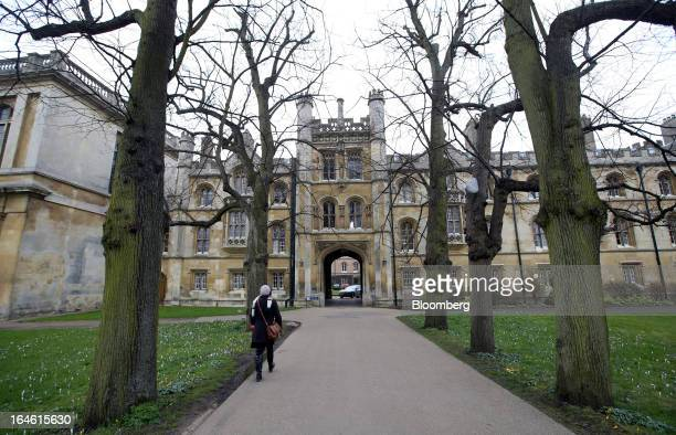A pedestrian walks towards Trinity College part of the University of Cambridge in Cambridge UK on Friday March 22 2013 In 2011 the UK's government...