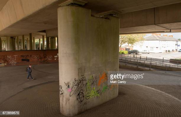 A pedestrian walks under a elevated roadway on April 25 2017 in Newport Wales The British Prime Minister Theresa May's visit to South Wales today to...