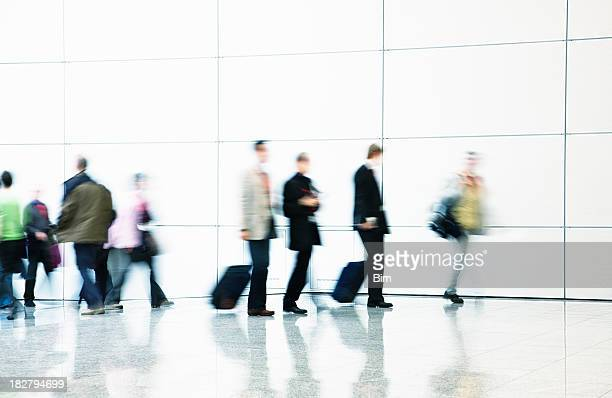 Pedestrians and Business Commuters Walking Down Hallway, Blurred Motion