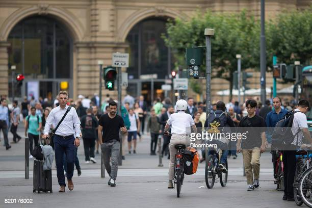 Pedestrians and commuters walk near the central train station in Frankfurt Germany on Thursday July 20 2017 Frankfurt has emerged as a winner of the...