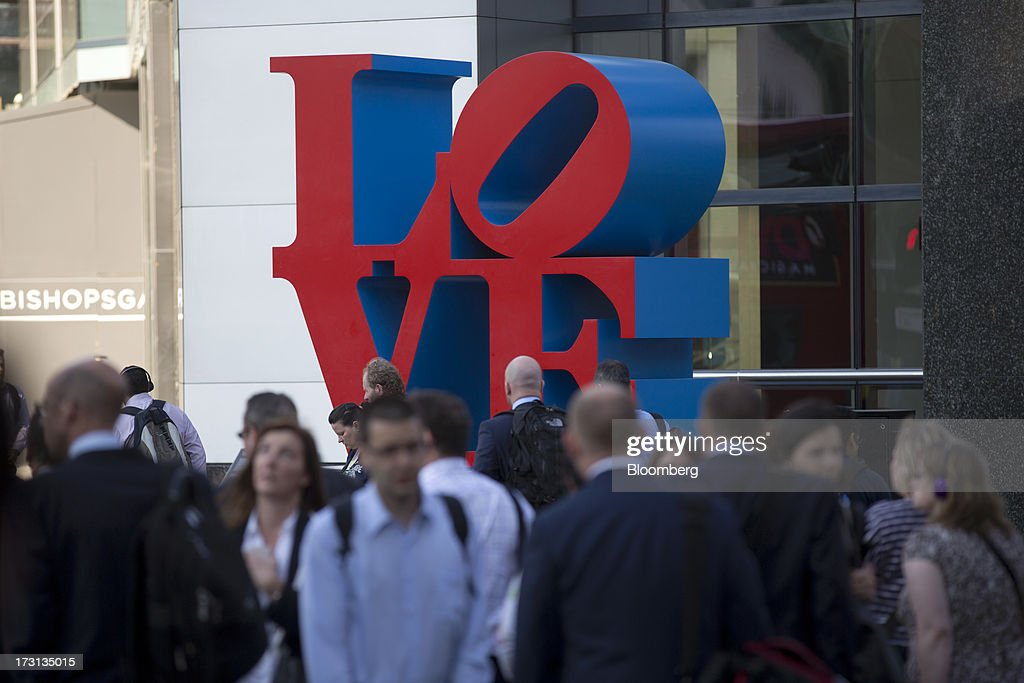 Pedestrians and commuters walk past an art installation outside the Tower 42 building in London, U.K., on Monday, July 8, 2013. Britain's economy could be in line for a period of 'strong catch-up growth' once it gets through the current weakness, according to Capital Economics Ltd. Photographer: Simon Dawson/Bloomberg via Getty Images