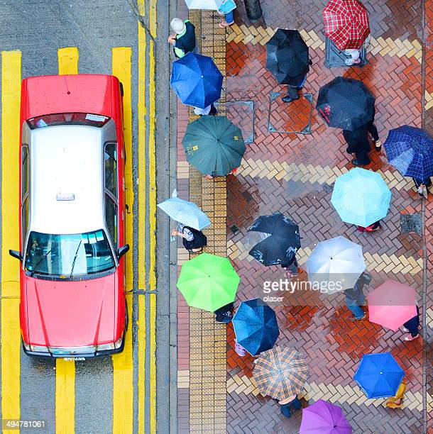Pedestrians and Hong Kong street in the rain