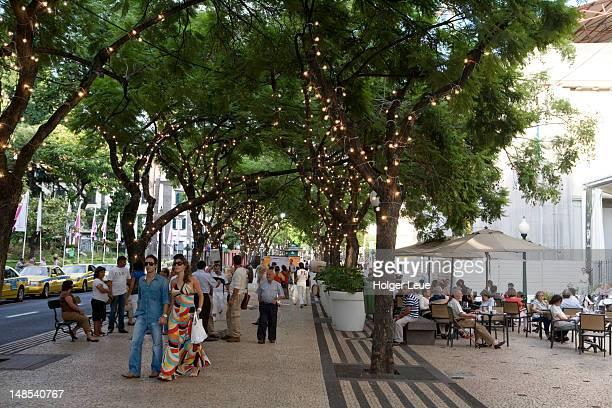 Pedestrians and outdoor cafe on Avenida Arriaga.