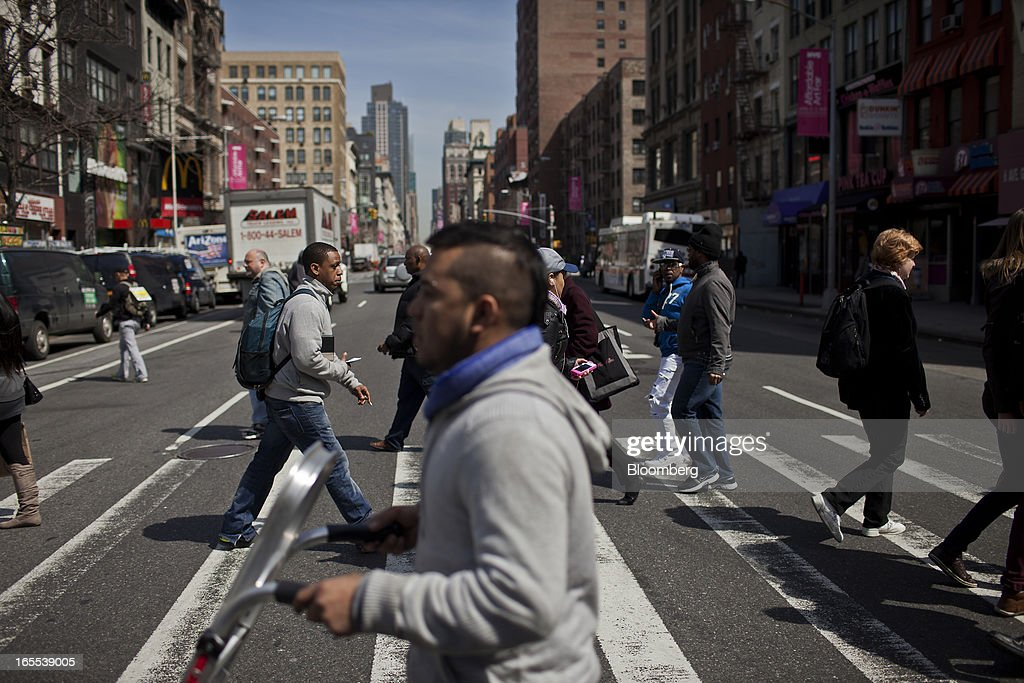 Pedestrians and shoppers cross the street in New York, U.S., on Thursday, April 4, 2013. Confidence among U.S. consumers stabilized last week, stemming a pullback in sentiment that had threatened to check recent gains in spending. Photographer: Victor J. Blue/Bloomberg via Getty Images