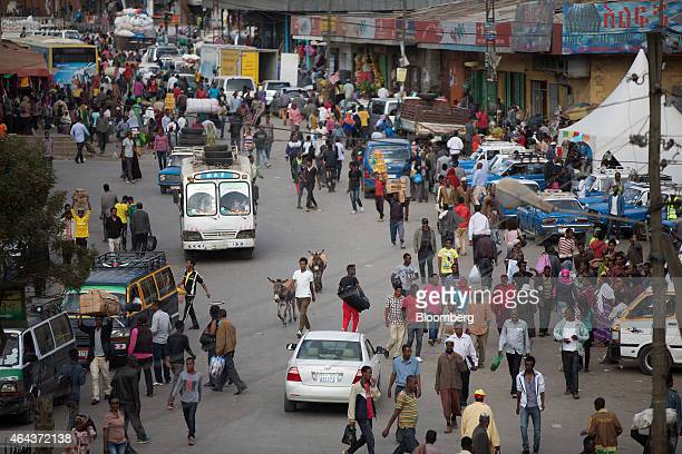 Pedestrians and shoppers walk along a street at the Merkato open air market in Addis Ababa Ethiopia on Tuesday Feb 24 2015 Ethiopia's arabica coffee...