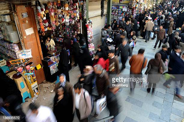 Pedestrians and storekeepers are seen on a street selling household appliances in the Bazaar Arz near Khayyam street in Tehran Iran on Thursday Jan...