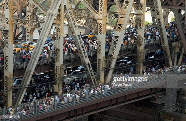 Pedestrians and traffic leaving downtown Manhattan crossing the Queensboro Bridge after the onset of the largest power blackout in American history...