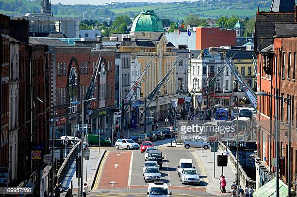 Pedestrians and traffic move along St Patrick's Street in Cork Ireland on Tuesday June 4 2013 Speaking to lawmakers in Dublin last month Irish...