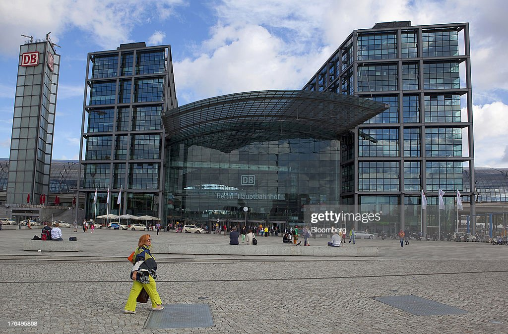 Pedestrians and travelers are seen outside Berlin Central Station, also known as Hauptbahnhof, in Berlin, Germany, on Tuesday, Aug. 13, 2013. German gross domestic product rose 0.7 percent from the first quarter and the French economy expanded 0.5 percent, the countries' national statistics offices said today. Photographer: Krisztian Bocsi/Bloomberg via Getty Images