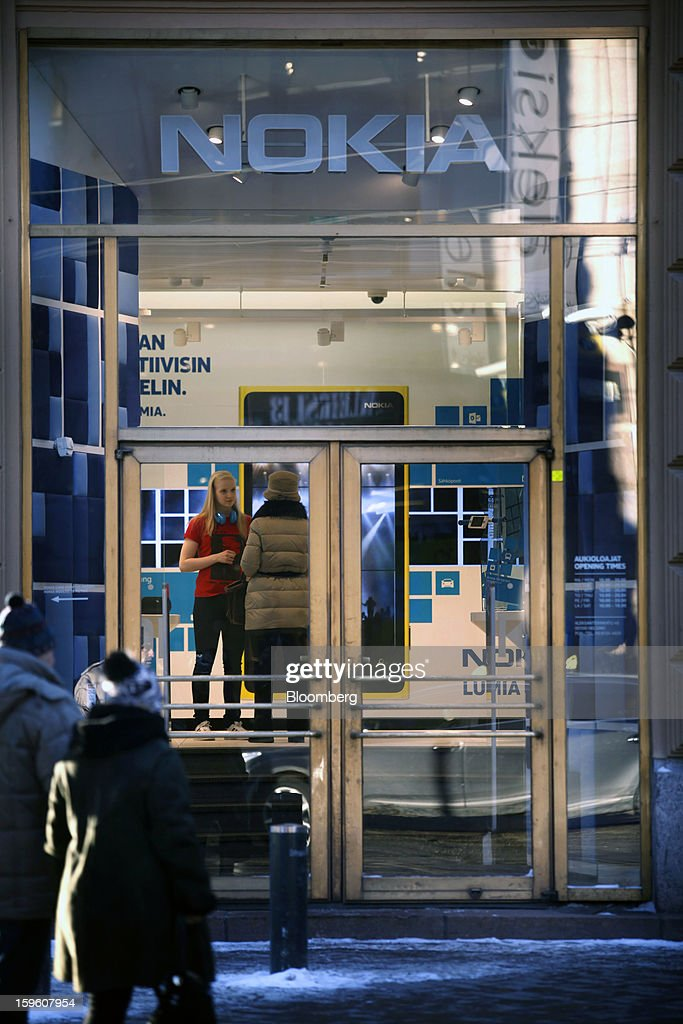 Pedestrians approach the entrance to a Nokia Oyj store in Helsinki, Finland, on Thursday, Jan. 17, 2013. The pace of Finland's debt growth is alarming and the country must undertake economic reforms together with reining in spending, Finnish Prime Minister Jyrki Katainen said in an op-ed piece published in newspaper Savon Sanomat. Photographer: Ville Mannikko/Bloomberg via Getty Images