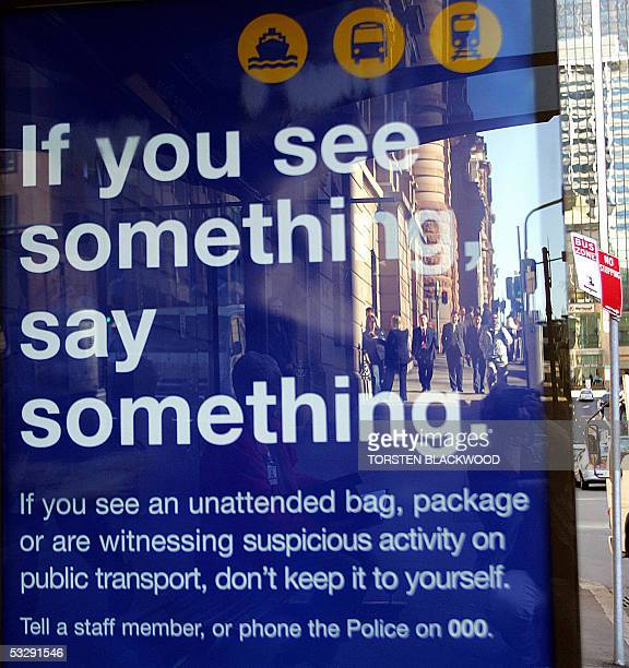 Pedestrians are reflected in a governmentsponsored antiterrorism poster displayed at a bus stop in Sydney 27 July 2005 in the aftermath of the London...