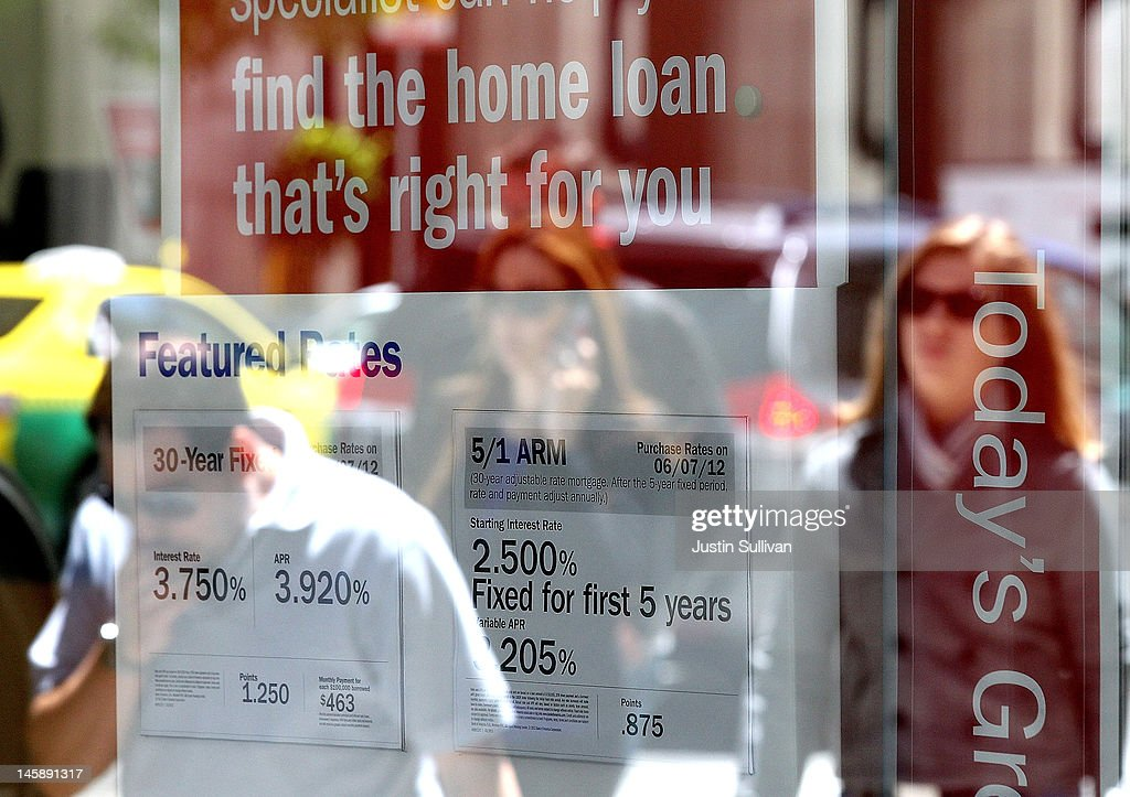 Pedestrians are reflected in a window as they walk by a sign displaying mortgage rates inside a Bank of America office on June 7, 2012 in San Francisco, California. Average rates for 30 and 15 year fixed mortgages fell for the sixth straight week to record lows. The 30 year loan fell to 3.67 percent from 3.75 percent last week and the 15 year mortgage dropped to 2.94 percent compared 2.97 percent one week ago.