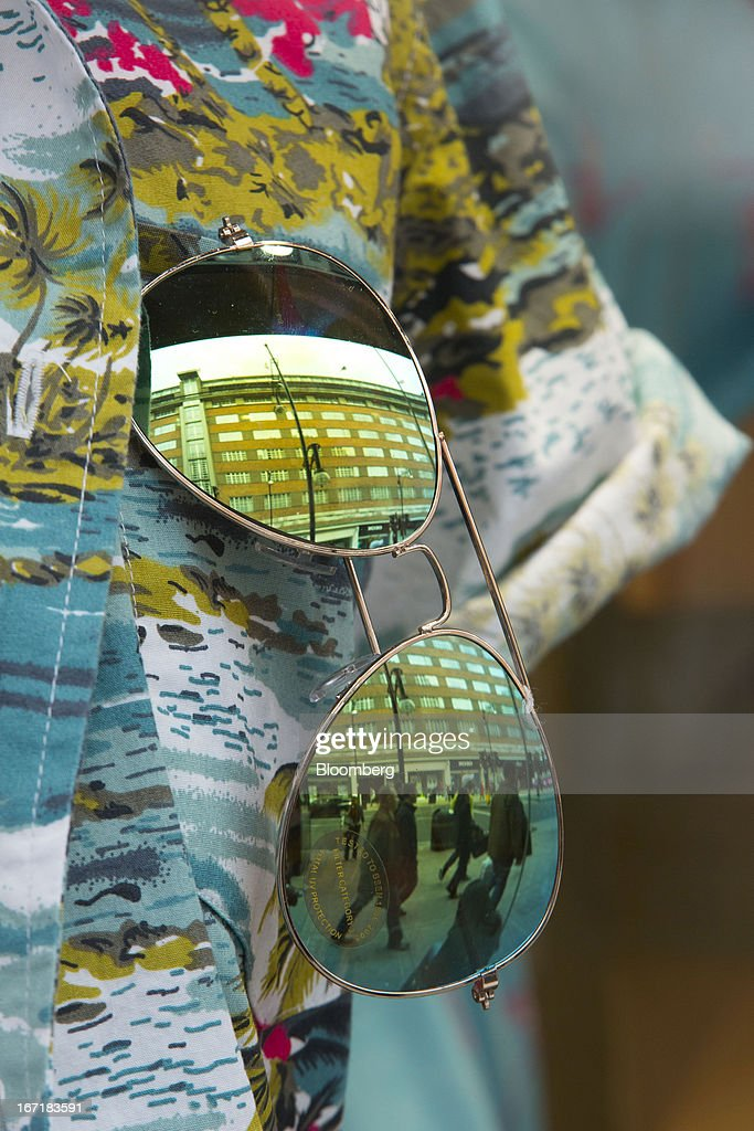 Pedestrians are reflected in the lens of a pair of sunglasses on display in the window of a Primark store on Oxford Street in central London, U.K., on Monday, April 22, 2013. Associated British Foods Plc, the owner of the Primark discount-clothing chain, fell the most in three months after Credit Suisse Group AG said it's unlikely the chain's profit growth can continue at the first half's pace. Photographer: Jason Alden/Bloomberg via Getty Images