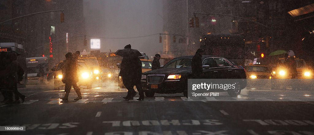 Pedestrians battle wind, snow and sleet as Manhattan experiences a major winter storm on February 8, 2013 in New York City. New York City along with much of the Northeast is expected to get a foot or more of snow through Saturday afternoon with possible record-setting blizzard conditions expected. Heavy snow warnings are in effect from New Jersey through southern Maine.