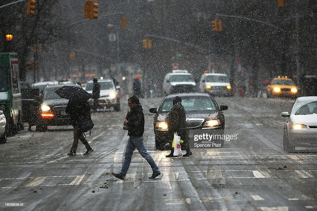 Pedestrians battle wind, snow and sleet as Manhattan prepares for a major winter storm on February 8, 2013 in New York City. New York City and much of the Northeast is expected to get a foot or more of snow through Saturday afternoon with possible record-setting blizzard conditions expected. Heavy snow warnings are in effect from New Jersey through southern Maine.