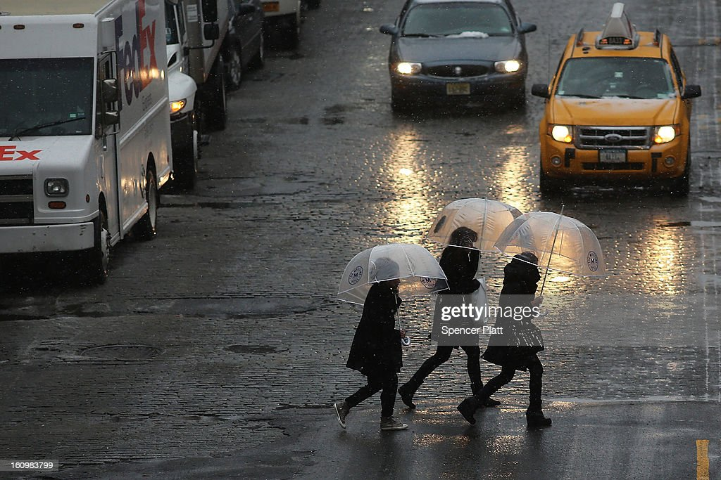 Pedestrians battle wind, snow and sleet during a major winter storm on February 8, 2013 in New York City. New York City and much of the Northeast is expected to get a foot or more of snow through Saturday afternoon with possible record-setting blizzard conditions expected. Heavy snow warnings are in effect from New Jersey through southern Maine.