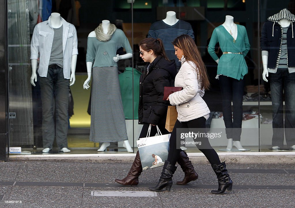 Pedestrians carry shopping bags while walking on Granville St. in Vancouver, British Columbia, Canada, on Monday, March 25, 2013. Statistics Canada (STCA) is scheduled to release consumer price index data on March 27, 2013. Photographer: Ben Nelms/Bloomberg via Getty Images