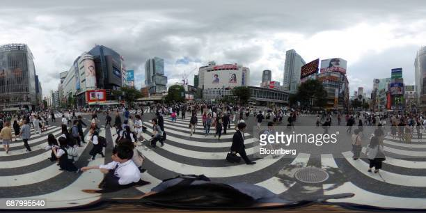Pedestrians cross a road in the Shibuya area of Tokyo Japan on Wednesday May 24 2017 Japan is scheduled to release Consumer Price Index figures for...