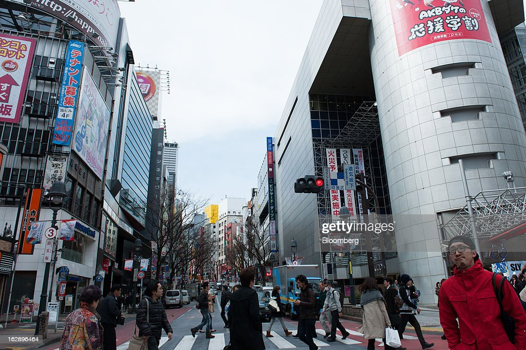 Pedestrians cross a street in the area of Shibuya in Tokyo, Japan, on Friday, March 1, 2013. Japan's consumer prices fell for the eighth time in nine months, highlighting the challenges facing the Bank of Japan in reaching a 2 percent inflation target. Photographer: Noriko Hayashi/Bloomberg via Getty Images