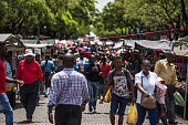 Pedestrians cross a street lined with market stalls in the central business district in Pretoria South Africa on Tuesday Dec 15 2015 South Africa's...