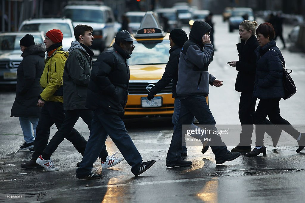 Pedestrians cross a street on Broadway at one of the deadliest intersections in Manhattan on February 18 2014 in New York City Following a surge in...