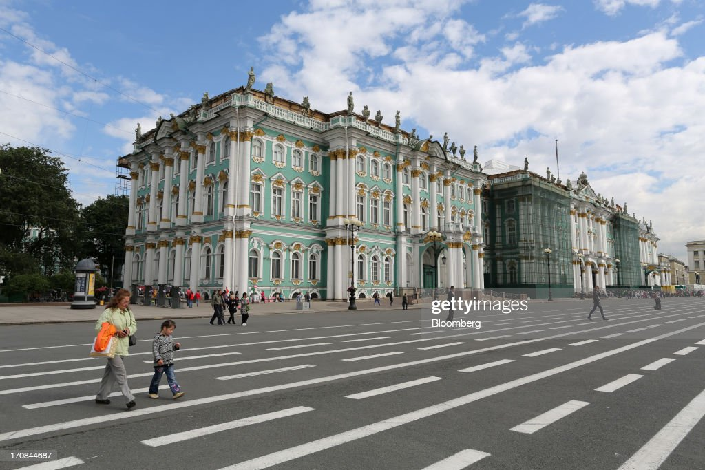 Pedestrians cross a street outside the Hermitage museum ahead of the St. Petersburg International Economic Forum 2013 (SPIEF) in St. Petersburg, Russia, on Wednesday, June 19, 2013. The Russian Deputy Prime Minister Igor Shuvalov told the conference that the country's World Trade Organization accession negotiations could be further delayed unless several remaining disputed matters are solved. Photographer: Andrey Rudakov/Bloomberg via Getty Images