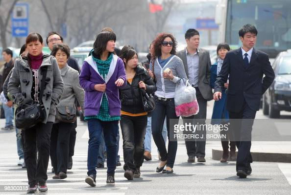 Pedestrians cross an intersection in Beijing on April 7 2010 In its twiceyearly update on East Asian and Pacific countries the World Bank said...