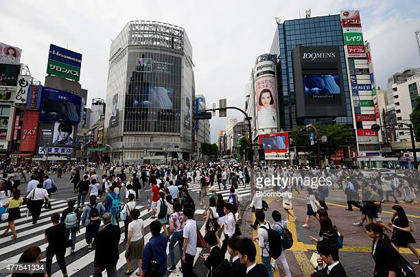 Pedestrians cross an intersection in the Shibuya district of Tokyo Japan on Wednesday June 17 2015 Bank of Japan Governor Haruhiko Kuroda said last...