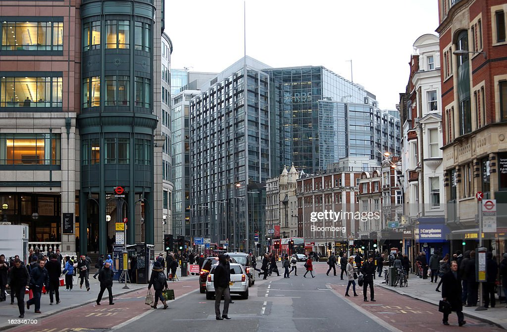 Pedestrians cross Bishopsgate against a backdrop of the headquarters of Royal Bank of Scotland Group Plc (RBS), center, in London, U.K., on Friday, Feb. 22, 2013. RBS, Britain's biggest publicly owned lender, was fined $612 million by regulators in the U.K. and the U.S. for rigging the London interbank offered rate and similar benchmarks. Photographer: Chris Ratcliffe/Bloomberg via Getty Images