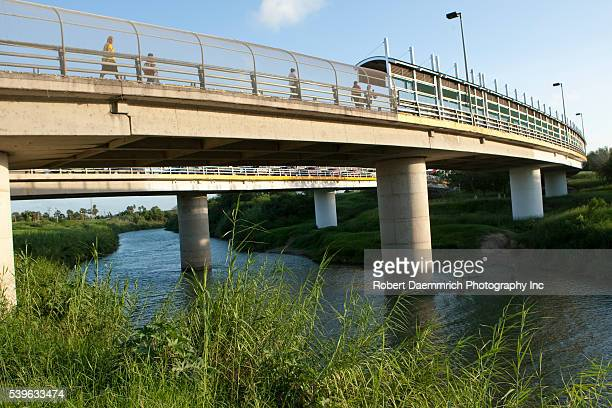 Pedestrians cross into Matamoros Mexico after shopping in the United States on one of two international bridges that span the Rio Grande River...