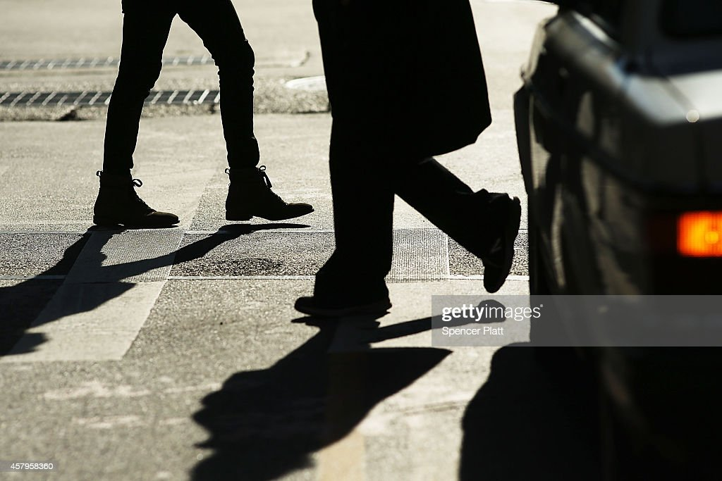Pedestrians cross the intersection of 3rd Avenue and 14th Street one of Manhattan's most dangerous crosswalks for pedestrians on October 27 2014 in...