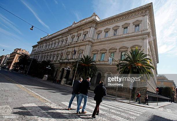 Pedestrians cross the road in front of the Banca d'Italia Italy's central bank in Rome Italy on Tuesday Feb 21 2012 Bank of Italy Director General...