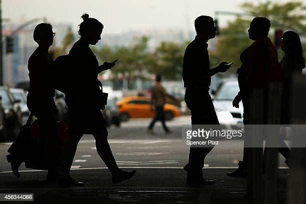 Pedestrians cross the street at a busy intersection on the West Side of Manhattan on September 29 2014 in New York City Three pedestrians have been...
