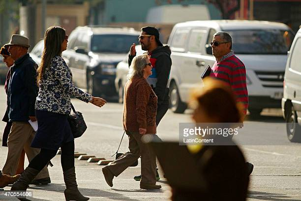 Pedestrians cross the street in downtown Concepcion on April 14th 2015 in Concepcion Chile Concepcion is one of the eight host cities of the next...