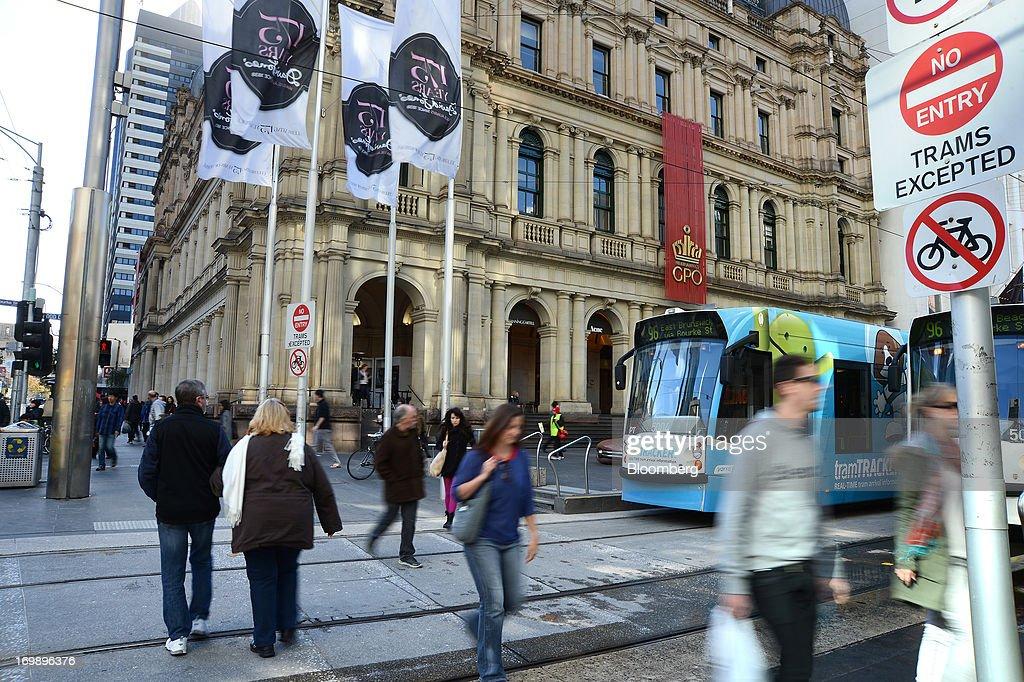 Pedestrians cross tram tracks in front of the GPO building on Bourke Street in central Melbourne Australia on Sunday June 2 2013 The Australian...
