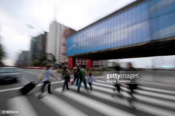 Pedestrians crossing Paulista Avenue in front of MASP