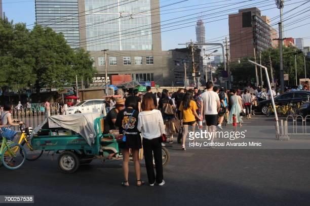 Pedestrians Crossing Street In Beijing
