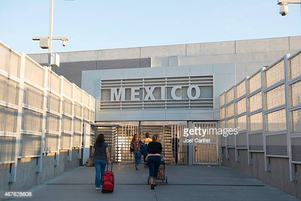 Pedestrians crossing US border into Tijuana, Mexico