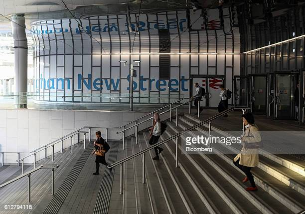 Pedestrians descend a staircase at the main entrance to Birmingham New Street station operated by Network Rail Ltd in Birmingham UK on Tuesday Oct 4...