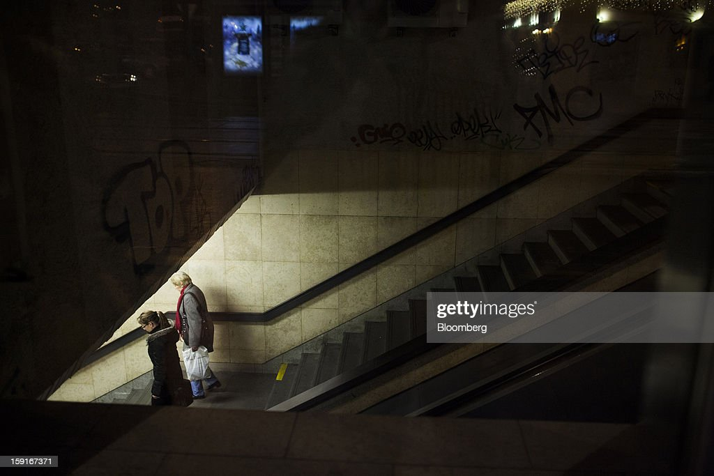 Pedestrians enter a metro station via a grafitti-covered stairway in Prague, Czech Republic, on Tuesday, Jan. 8, 2013. The Czech economy is showing weak domestic demand as households and businesses cut spending due to government austerity programs and the euro area's debt crisis. Photographer: Bartek Sadowski/Bloomberg via Getty Images