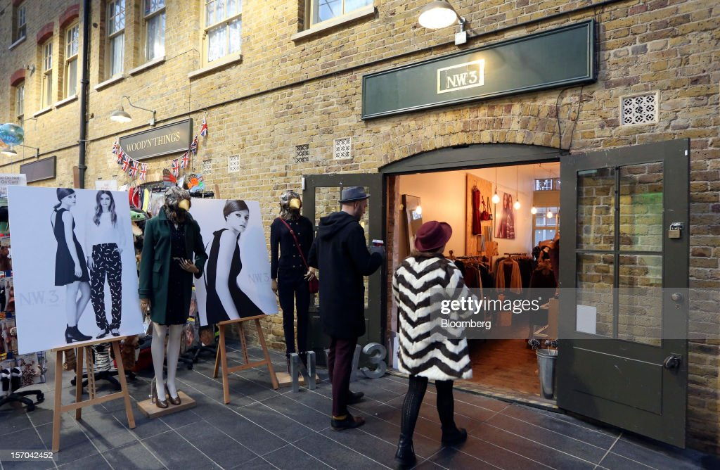 Pedestrians enter a NW3 store, a brand of Hobbs and former pop-up store, in London, U.K., on Tuesday, Nov. 27, 2012. Fashion chain Hobbs is among those that have opened pop-up stores for the first time this year, while CD and DVD retailer HMV Group Plc is adding more than usual for the holiday in an effort to win business. Photographer: Chris Ratcliffe/Bloomberg via Getty Images