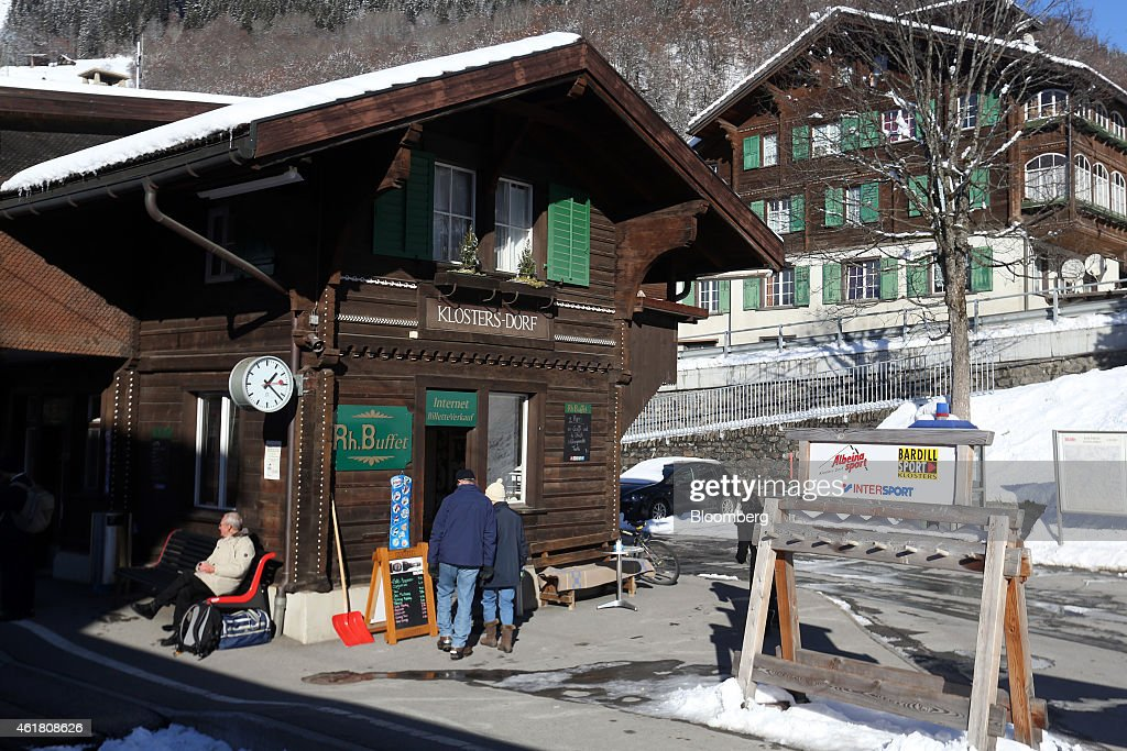 Pedestrians enter a store advertising internet access on a sign above its doorway at KlostersDorf railway station in Klosters Switzerland on Monday...
