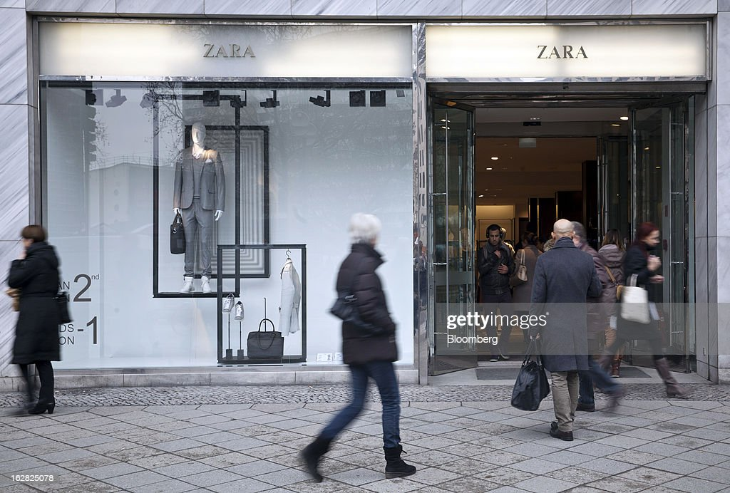 Pedestrians enter a Zara store, operated by Inditex SA in Berlin, Germany, on Wednesday, Feb. 27, 2013. German unemployment unexpectedly fell in February amid signs that Europe's biggest economy is returning to growth after a contraction at the end of last year. Photographer: Balint Porneczi/Bloomberg via Getty Images