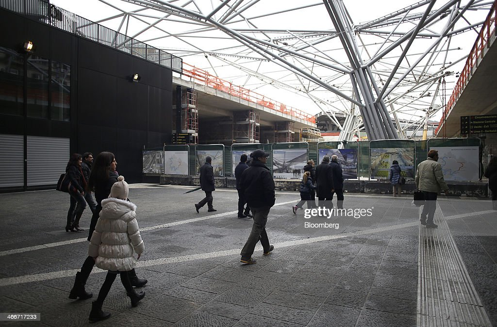 Pedestrians exit a subway train at an underground station in Naples, Italy, on Saturday, Feb. 1, 2014. In Naples, the local youth unemployment rate in 2012 was 53.6 percent compared to a national average of 35.3 percent. Photographer: Alessia Pierdomenico/Bloomberg via Getty Images