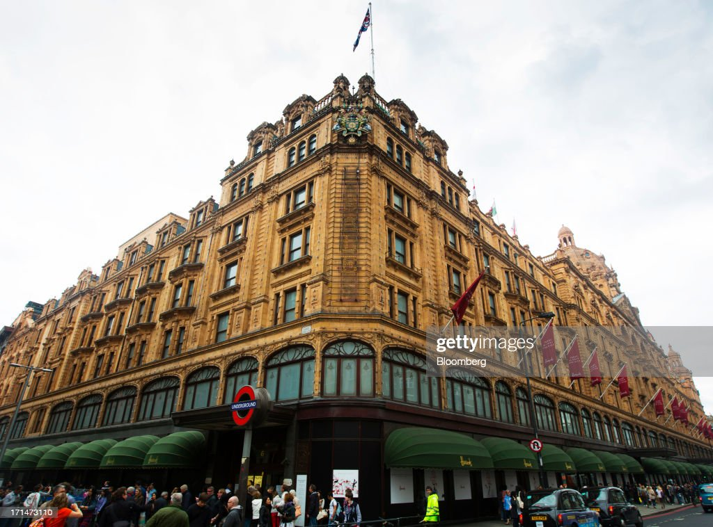 Pedestrians gather outside Harrods luxury department store in London, U.K., on Monday, June 24, 2013. Harrods, which has more than 1 million square feet (90,000 square meters) of selling space, isn't concerned about the outlook for spending on luxury goods, Harrods Managing Director Michael Ward said. Photographer: Jason Alden/Bloomberg via Getty Images
