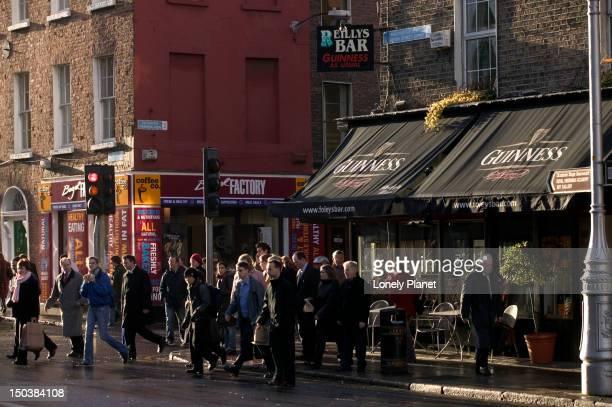 Pedestrians in street around Merrion Square.