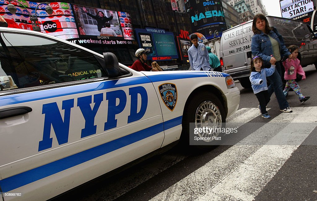 Pedestrians in Times Square walk past a police car May 26 2004 in New York City The US fears that al Qaeda may be plotting an attack inside the...